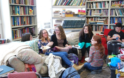 College senior Talia Greenberg (left), College sophomore Talia Rodwin, College junior Becky Berenbon, College sophomore Emily Volz, double-degree fifth year Einav Silverstein and College sophomore Simon Regenold share a laugh at Hillel's Chocolate Seder. The coming week is Religious Life Week, which will include the release of a new report on religious life on campus.