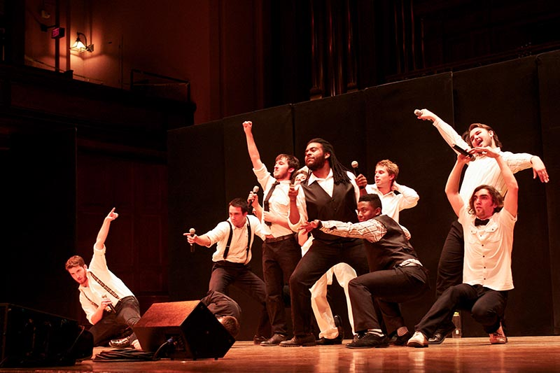 The Obertones strike poses during a rousing performance. Their show, The Great Finney Heist, included elements of theater and comedy not often found in a cappella performances.