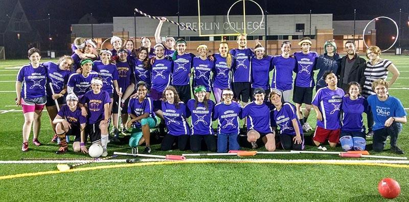 The quidditch team poses for a celebratory photo after defeating Ashland University in its first-ever home game at the Austin E. Knowlton Athletic Complex last Friday. Quidditch officially became a club sport earlier this semester.