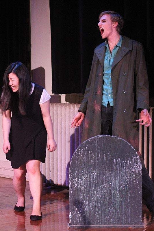 Double-degree junior James Quintana screams at a terrified Mariko Wakayama, College senior, in the musical REPO: Testify!. The senior TIMARA recital entertained audiences with catchy music and gory special effects last Friday night.