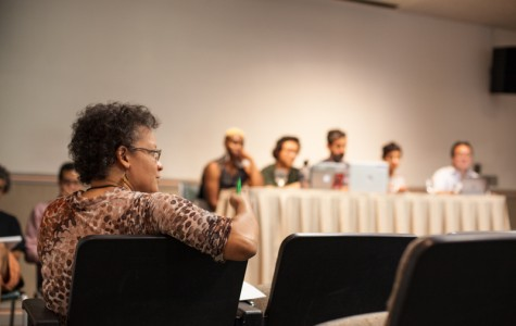 Associate Dean of Students and Dean of the Class of 2016 Kimberly Jackson Davidson, a member of the search committee for a new director of the Multicultural Resource Center, watches fellow committee members address student concerns at a listening session on Tuesday.