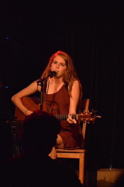 College junior and pop singer-songwriter Kristin McFadden performs original music at the Cat in the Cream. McFadden started a songwriting club last year with College junior Rob Jamner to provide more resources for the songwriting com- munity at Oberlin.