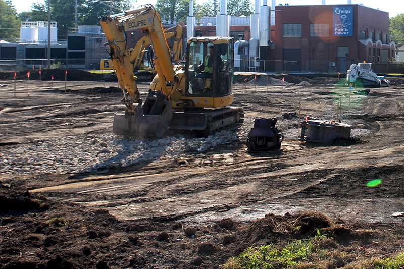 A construction worker plows through the worksite of the new Lorain County Health & Dentistry clinic at 260 South Main Street. The clinic is expected to open in early 2016.