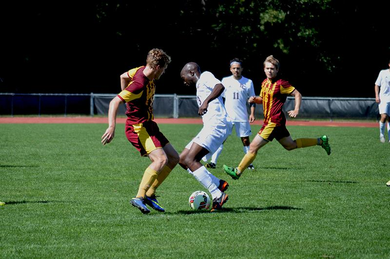 Sophomore forward Timothy Williams attempts a tackle at midfield against the Quakers of Earlham College. The men's soccer team beat Earlham 4-1and is currently 4–2 this Season