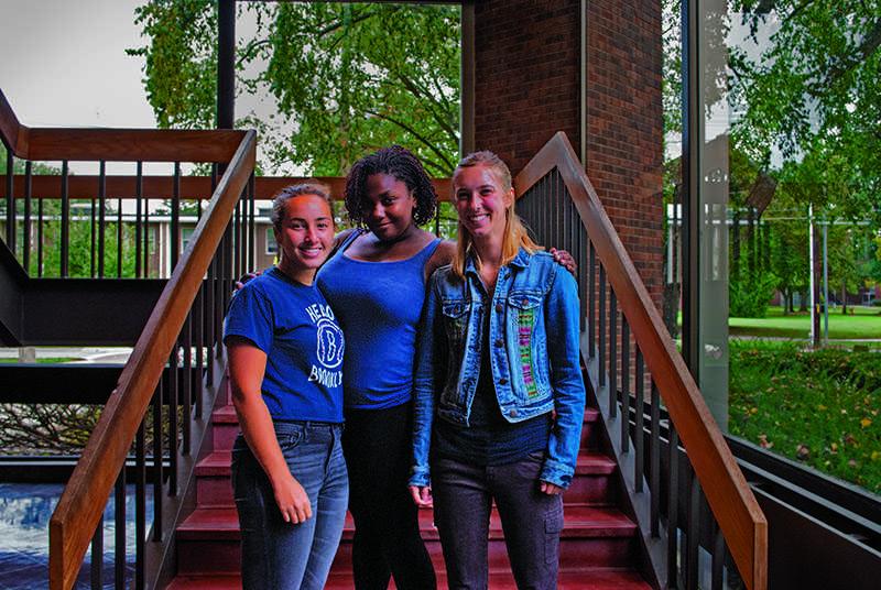 Junior Emma Brezel (left), senior Ariana Abayomi and junior Olivia Hay
