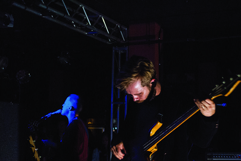 Geoff+Graham%2C+OC+%E2%80%9904%2C+of+Lower+Dens+cradles+his+bass+guitar+while+bandleader+Jana+Hunter+sings+material+from+the+band%E2%80%99s+new+release%2C+Escape+From+Evil.+The+band+has+recently+gained+popularity+and+received+numerous+positive+reviews%2C+yet+few+attended+their+performance+last+Monday+at+the+%E2%80%99Sco.