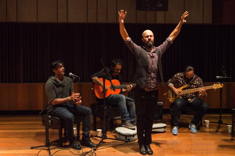 Nin%CC%83o+de+los+Reyes+dances+to+flamenco+music+played+by+vocalist+Ismael+Fernandez+%28left%29%2C+acoustic+guitarist+Juan+Escobar+and+bass+guitarist+Alain+Perez.+The+world-+renowned+Flamenco+artists+performed+as+part+of+a+three-day+residency+hosted+by+Oberlin%E2%80%99s+Performance+and+Improvisation+series.