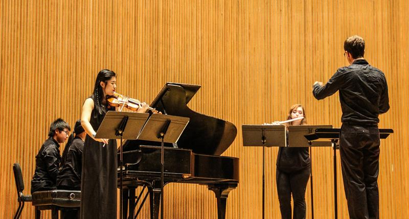 "Conservatory first-year pianist Jay Hwan Kim, Conservatory first-year violinist XinYuan Wang and College sophomore flutist Kelsey Burnham play in Conservatory first-year Hao Zou's piece, ""Unspeakable Landscapes."" The Student Composers concert, in which Zou's piece was performed, covered diverse stylistic territory."