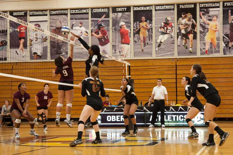 Sophomore+middle+hitter+Dana+Thomas+spikes+the+ball+over+Earlham+College%E2%80%99s+Abigail+Sheehan.+Thomas+had+seven+kills+and+two+blocks+as+the+Yeowomen+beat+the+Quakers+3%E2%80%931+this+past+Saturday.+Oberlin+was+subsequently+defeated+by+Hiram+College+this+past+Wednesday+and+is+currently+6%E2%80%938+overall+and+2%E2%80%931+in+conference.