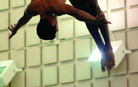 Senior diver Benjamin Miyamoto curls into his 3-meter dive at Oberlin's Robert Carr Pool at the swimming and diving team's home opening meet. The College of Wooster Fighting Scots defeated the Yeomen and Yeowomen 207–87 and 161–135, respectively.