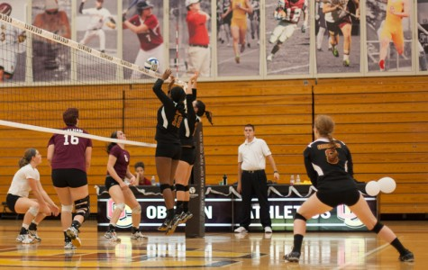 Sophomore middle hitter Dana Thomas and junior setter Meredith Leung leap to block a hit during their game against Earlham College on Sep. 26. The Yeowomen won the match 3–1 and concluded their season this weekend, finishing 2–6 in conference and 8–19 overall.