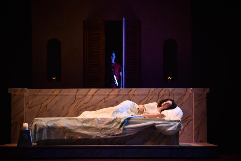 As Lucretia, Conservatory senior Rebecca Printz rests while Tarquinius, played by Conservatory senior Michael Floriano, lurks in a doorway. The Rape of Lucretia, performed Nov. 11, 13, 14 and 15 by Oberlin Opera Theater and the Contemporary Music Ensemble, uses sexual violence against the title character as a metaphor for the destruction of Western Europe during World War II.