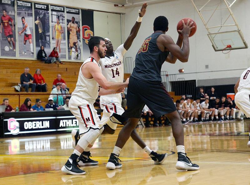 Senior center and Review Sports Editor Randy Ollie protects the ball from his Muskingum University opponent in the Yeomen's home opener Tuesday night. The Yeomen's 102–94 victory over the Fighting Muskies brought them to a promising 2–0 to start their season.