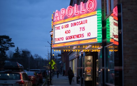 The Apollo Theatre advertises Pixar's newest film, The Good Dinosaur. Despite excellent visuals and an appealing central concept, the film fails to live up to the high expectations Pixar has set for itself.