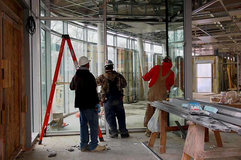 Construction workers assess the situation within the new Lewis Gateway Center, which the College borrowed $18 million to build. The rating agency Moody's Investors Services recently downgraded the College's credit rating partially because of the College's debt level.