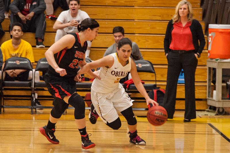 Senior guard Lindsey Bernhardt drives the baseline against an Ohio Wesleyan University defender. The Yeowomen delivered on their Senior Day match against the Battling Bishops, closing out the close game 62–56.