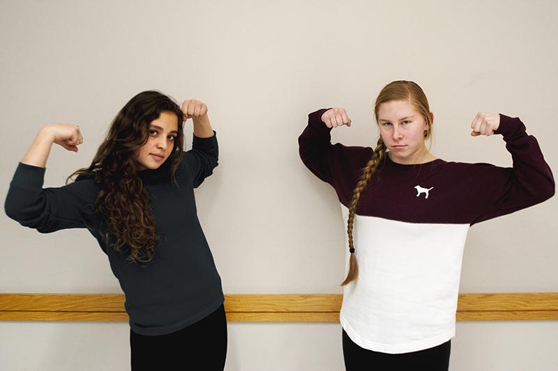 Junior softball captains Ariana Enzerink (left) and Tori Poplaski