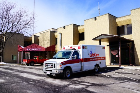 A Life Care ambulance vehicle parked outside of the emergency entrance to Mercy Allen Hospital. Local Senators Rob Portman and Sherrod Brown recently passed legislation that could change the hospital's heroin policies.