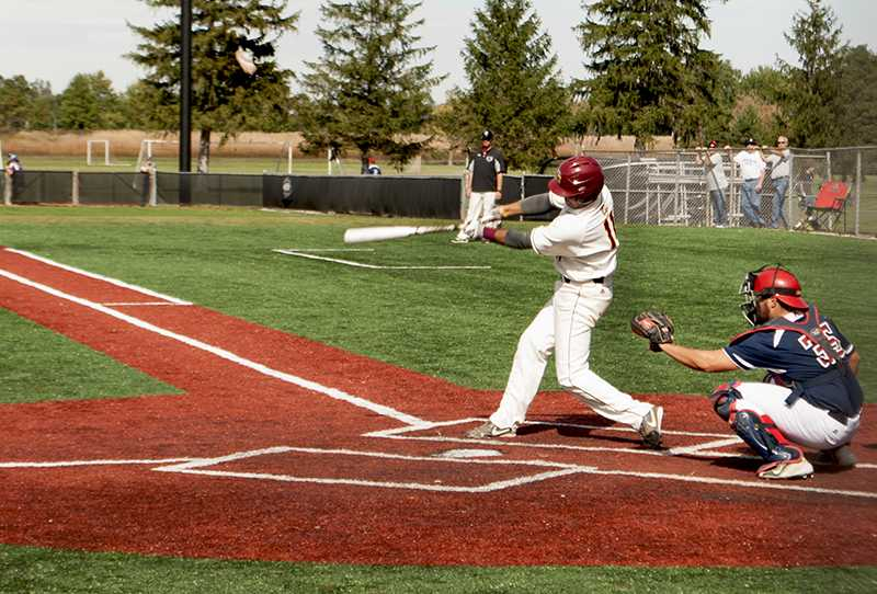 Junior infielder Mike Masella cracks a hit during a Yeomen home game on Dill Field. The baseball team is currently in preseason, anticipating a good defensive game for its first matchup against Ohio Northern University March 12 in Ada, Ohio.
