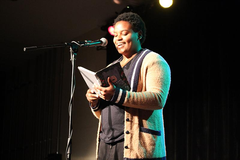 College junior and OSLAM member Misaël Syldor presents a slam poem at the Cat in the Cream Saturday. OSLAM's Valentine's Day-themed performance focused on feminism and relationships.