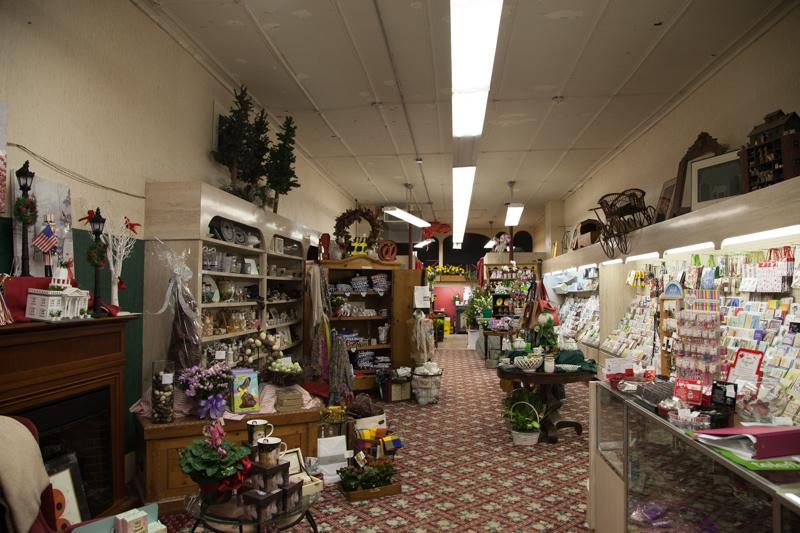Gifts and cards line the shelves of Carlyle Flower Shop. The store's longtime owners plan to celebrate Carlyle's 80th anniversary this year.