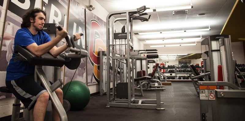 College sophomore Josh Biales uses the weight room at Philips gym. New quiet hours in the weight room are in effect every Monday through Friday from 9 to 11 a.m. and 1 to 3 p.m.