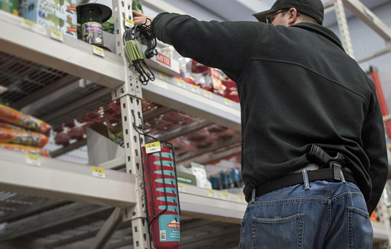 An armed Oberlin resident shops at Wal-Mart. House Bill 48 would increase the amount of public places where licensed owners can carry concealed weapons.