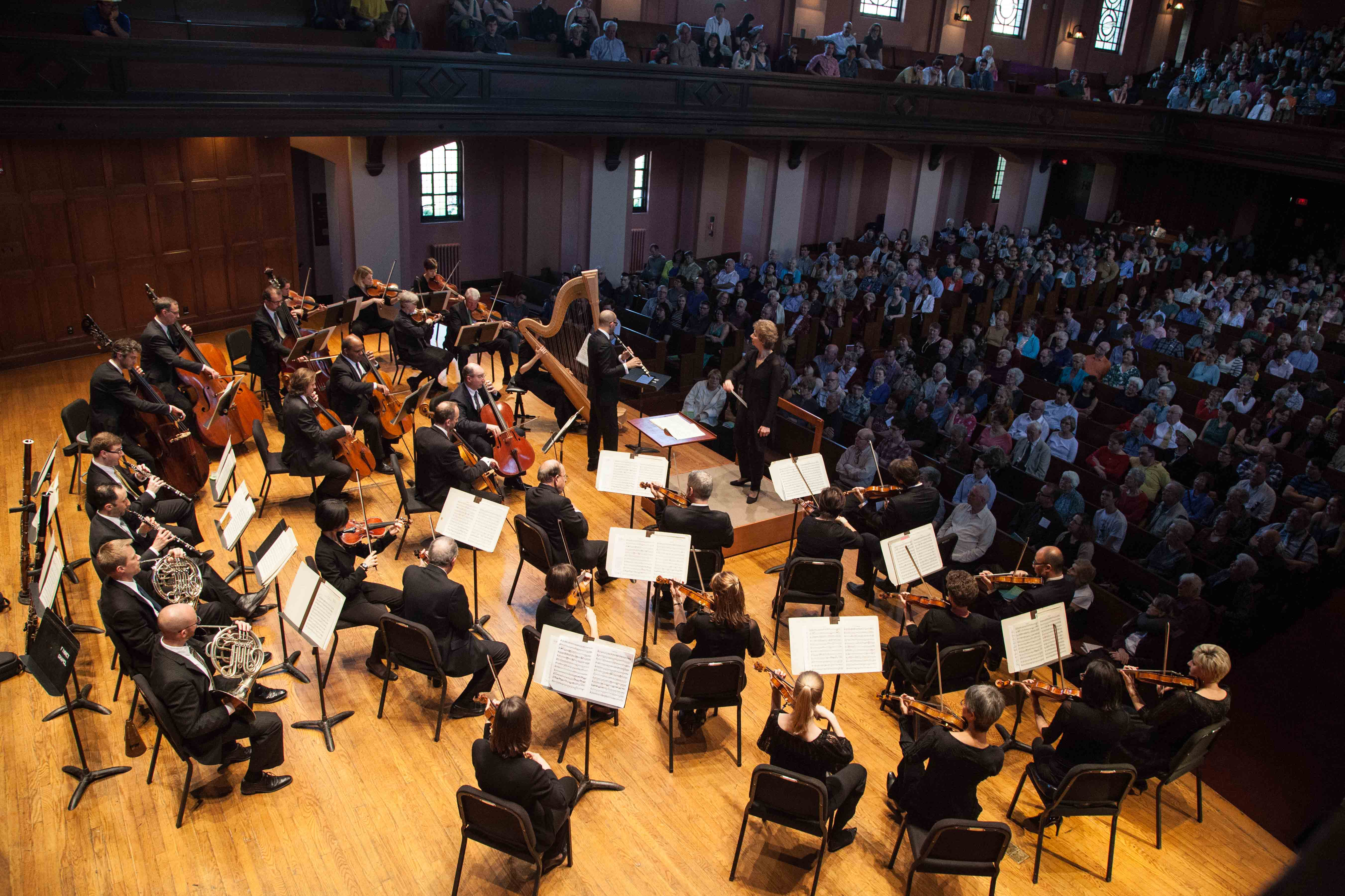 Jane Glover conducts the Cleveland Orchestra in Finney Chapel Sunday. The concert's program featured renowned compositions by Haydn and Mozart.