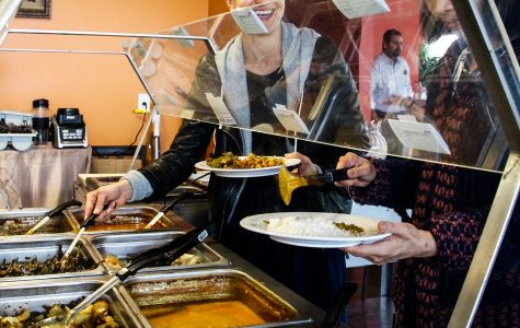 Patrons serve themselves at India Garden's buffet. The restaurant opened on April 21 and occupies Magpie Pizza's old space.