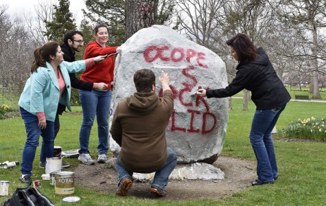 "Members of Oberlin College and Professional Employees paint a rock in Tappan Square to read, ""OCOPE is Rock Solid."" They will enter contract negotiations with the College on April 12."