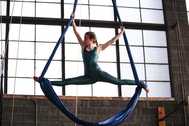 College+sophomore+Anika+Lindsey+showcases+her+fish-themed+routine+during+the+OC+Aerialists+performance%2C+%27Menagerie.%27+The+aerialists%2C+clad+in+colorful+animal+costumes%2C+presented+a+cohesive+show+complete+with+silks%2C+hoops+and+tightrope+acts.