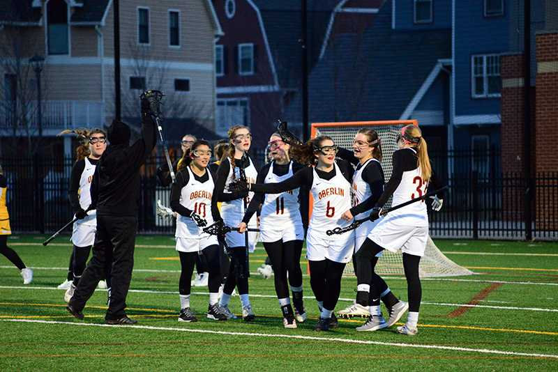 Several Yeowomen celebrate their 15–10 victory against the Baldwin Wallace University Yellow Jackets March 2. Oberlin defeated Ohio Wesleyan University Saturday by a score of 15–5, improving them to 7–3 overall and 2–0 in conference play this season.