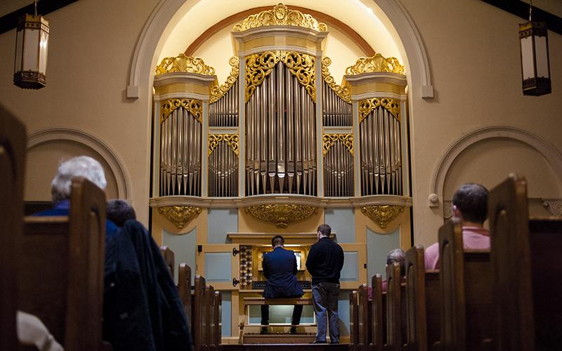 Ian Tomesch, OC '10, plays the David and Sigrid Boe organ at Peace Community Church. The church is celebrating its 150th anniversary this year.