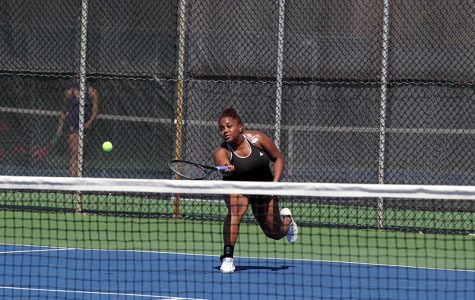 inSenior Ariana Abayomi swings a forehand over the net in singles play. The Yeowomen beat the Gators 7–2 Saturday in the final match of their regular season.
