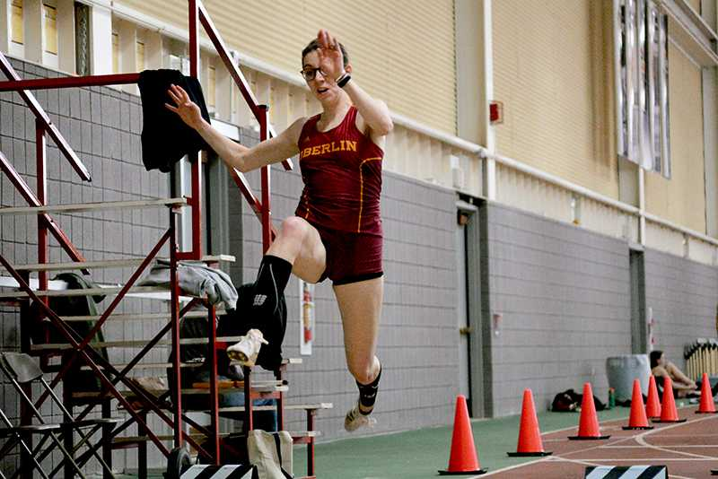 Sophomore+Annie+Goodridge+vaults+over+the+sand+pit+during+a+triple+jump.+Goodridge%E2%80%99s+firstplace%0A11-meter+jump+was+one+of+many+highlights+for+the+men%E2%80%99s+and+women%E2%80%99s+track+teams+at+the%0ABob+Kahn+Invitational+at+Oberlin.