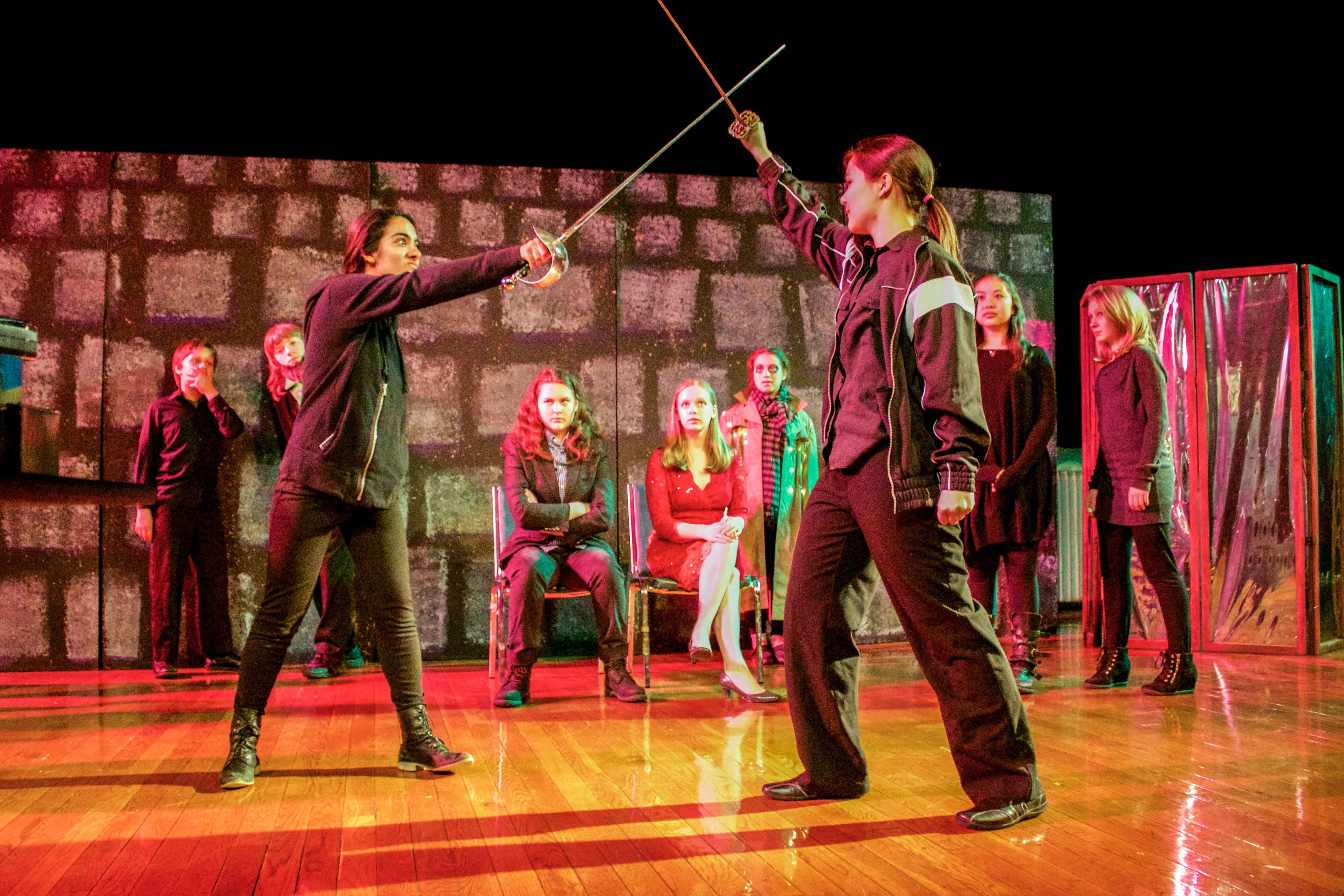 Daria Martz, 13, and Alison Chan, 14, duel as part of Oberlin Children's Shakespeare Project. The group will perform Hamlet on Friday and Saturday at 7 p.m. in Wilder Main.