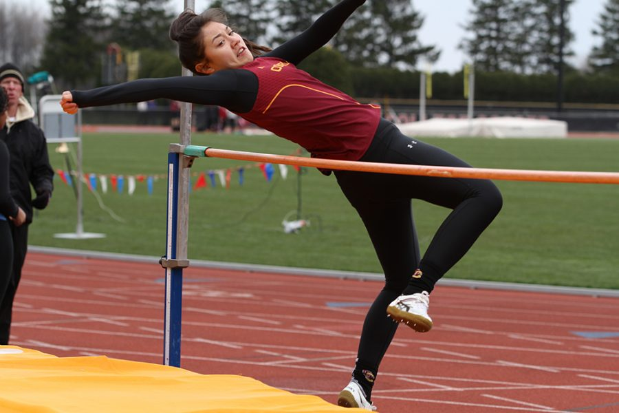 Sophomore Lisa Carle throws herself over the bar for the high jump Saturday. The track and field team traveled to Granville, Ohio, to compete in the 2016 North Coast Athletic Conference Outdoor Track and Field Championships this morning.