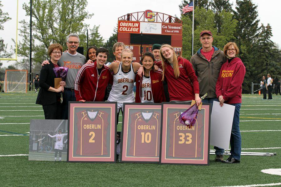Seniors+Emily+Kipling%2C+Taylor+Swift%2C+Suzanna+Doak+and+Grace+Barlow+stand+with+their+families+during+the+women%E2%80%99s+lacrosse+team%E2%80%99s+Senior+Day+celebration.+The+Yeowomen+ended+their+season+Saturday%2C+losing+a+nail-biter+to+The+College+of+Wooster+14%E2%80%9313.