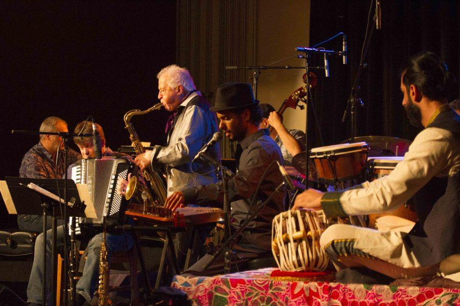 Professor Jamey Haddad performs with a diverse group of fellow musicians at the Cat in the Cream Wednesday. The group aims to invite audiences into a world of musical positivity and harmony.