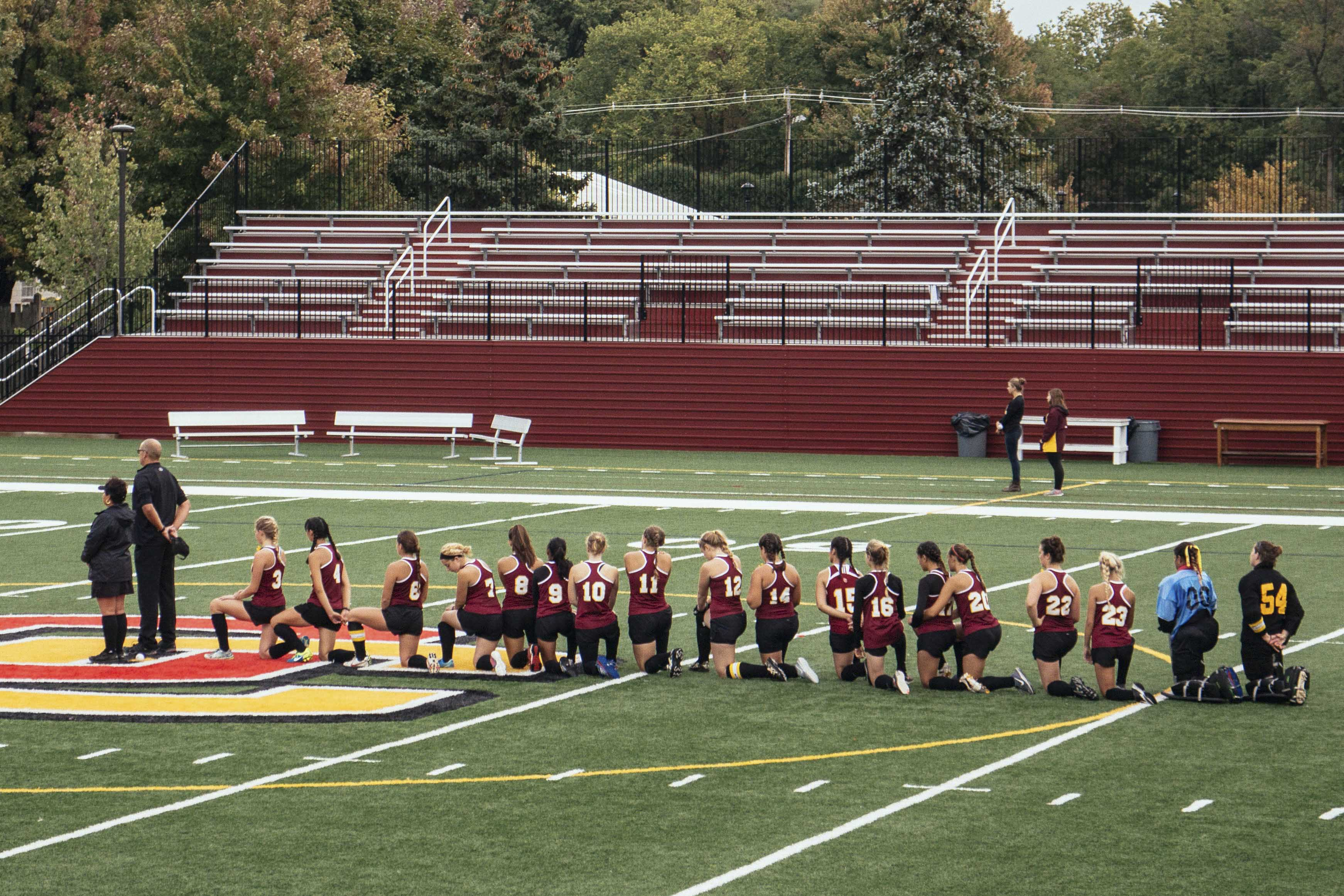 The Yeowomen kneel during the national anthem before facing off against NCAC foe Denison University last Thursday.