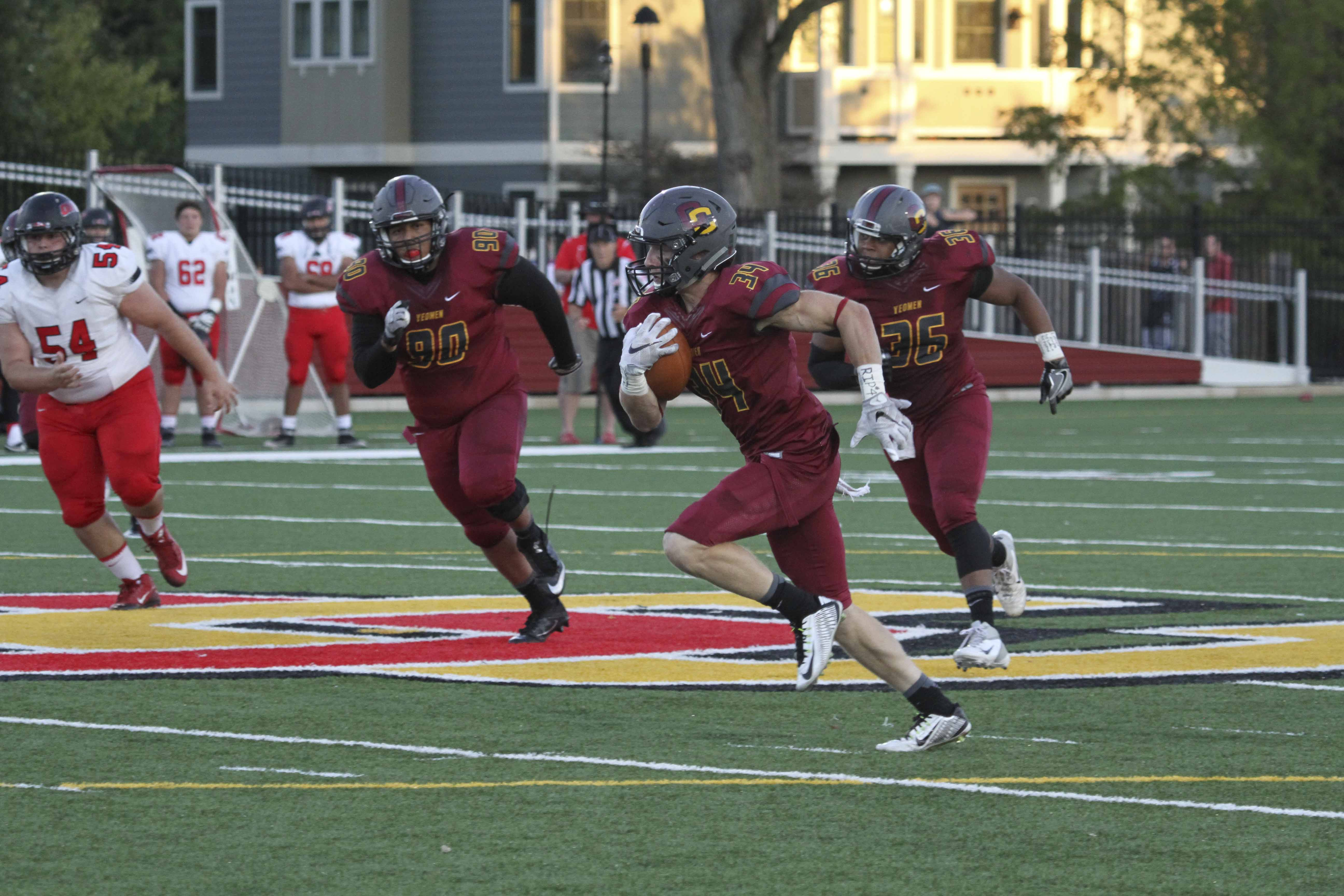 Junior defensive back Bennett Jackson dodges defenders after intercepting a pass against Ohio Wesleyan University Saturday. Jackson eventually returned the interception 55 yards for a touchdown in Oberlin's 29–16 loss.