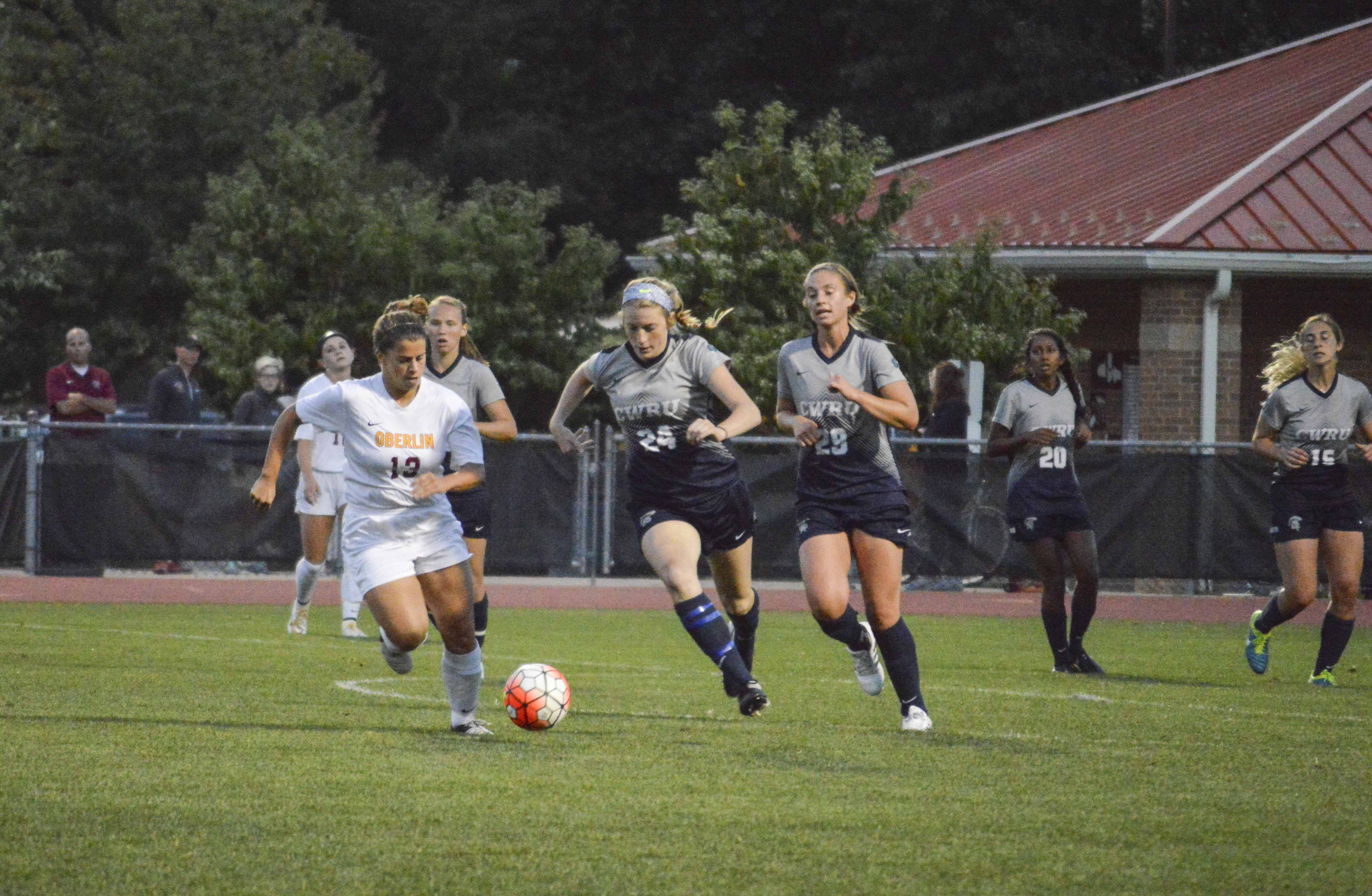 Senior center midfielder Tyler Sloan fends off a Case Western Reserve University Spartan during the women's soccer home opener on Thursday. The Yeowomen fell to the Spartans 1–0.