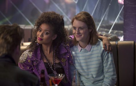 """Characters Kelly (Gugu Mbatha-Raw, left) and Yorkie (Mackenzie Davis, right) begin a relationship that will undergo the test of time in """"San Junipero,"""" the fourth of six new episodes in season three of Netflix's Black Mirror."""