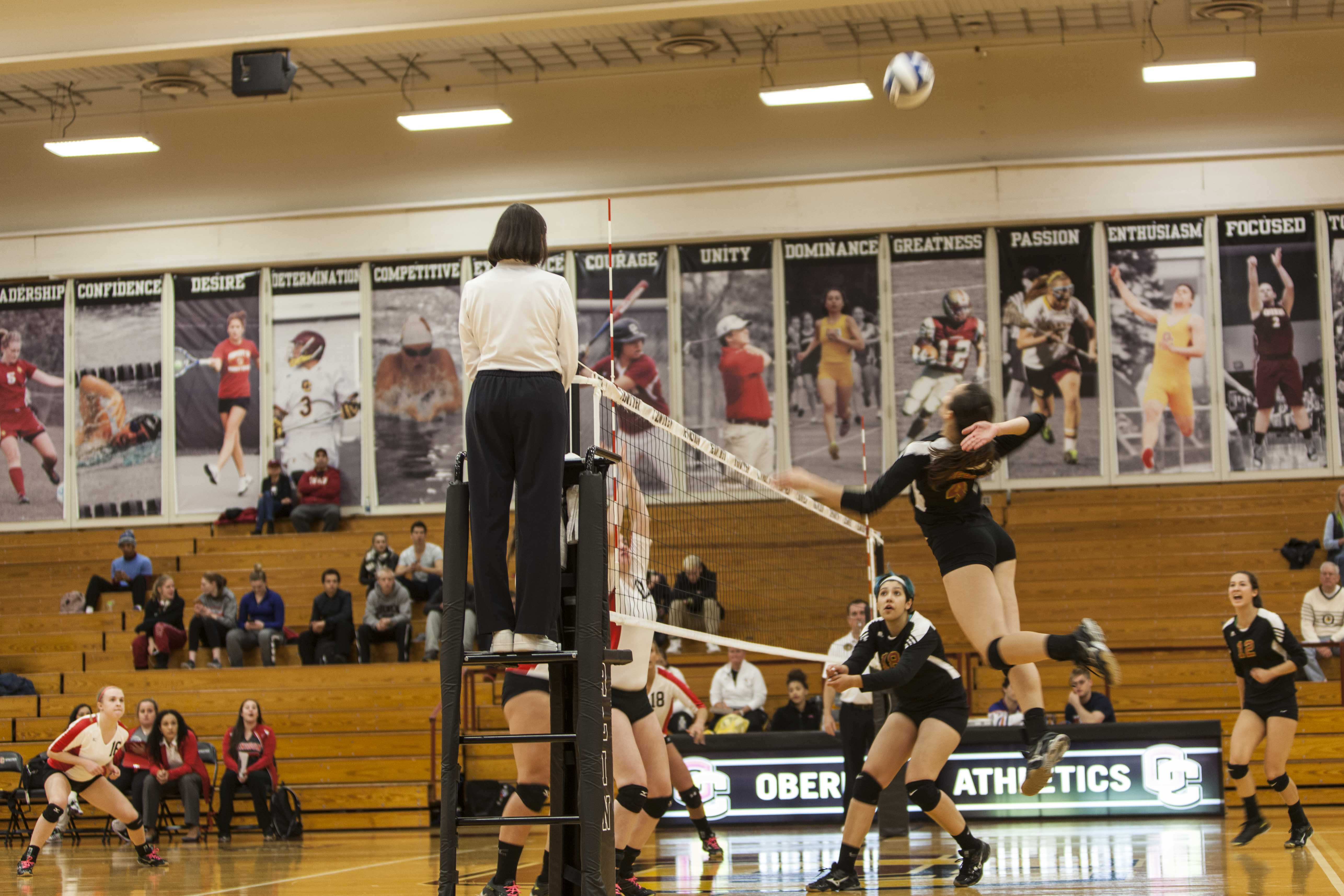 Senior Jillian Hostetler leaps for a spike against Denison University on Wednesday.