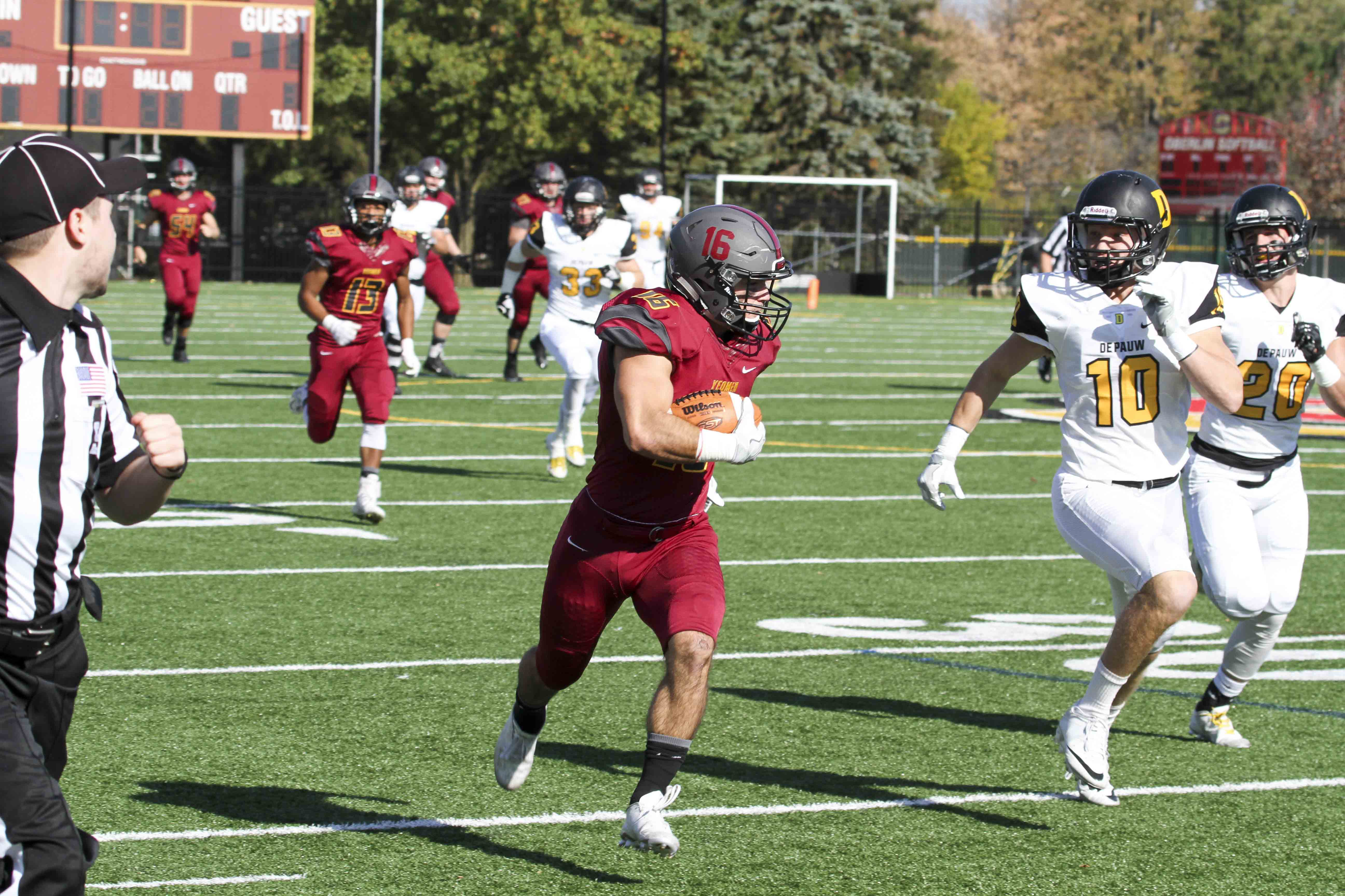 Senior wide receiver Justin Cruz sprints past DePauw University defenders in Oberlin's 50–17 loss last Saturday at the Knowlton Athletic Complex. Cruz ranks third in school history with 2,156 career receiving yards.