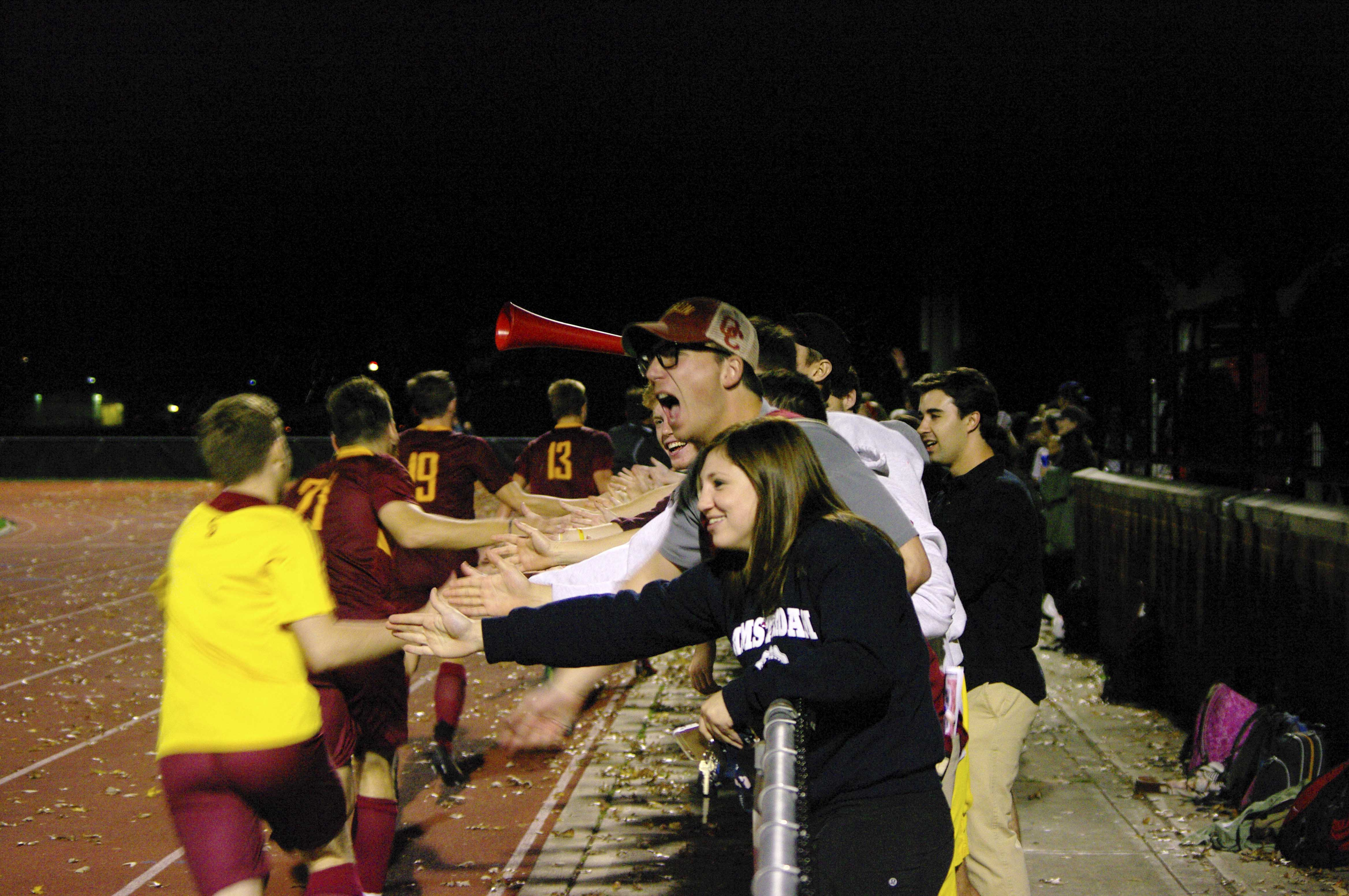 Fans congratulate the Yeomen after their 2–1 NCAC semifinal victory over Wabash College. The victory propelled the team to its first conference championship match in school history.