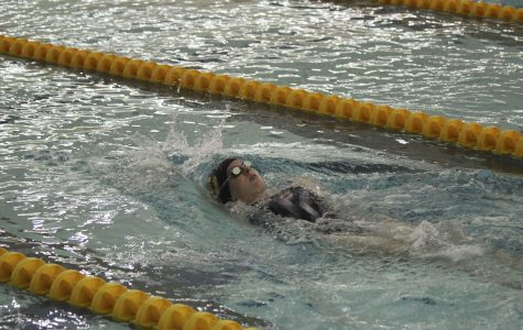 Senior captain Nora Cooper swims in Oberlin's first home meet of the season against Hiram College. The Yeowomen earned 141 points to defeat the Terriers.