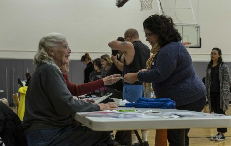 Community members check in with staff members at the polling center in Philips gym. The other polling centers in Oberlin included the Zion Community Development building and Kendal at Oberlin.