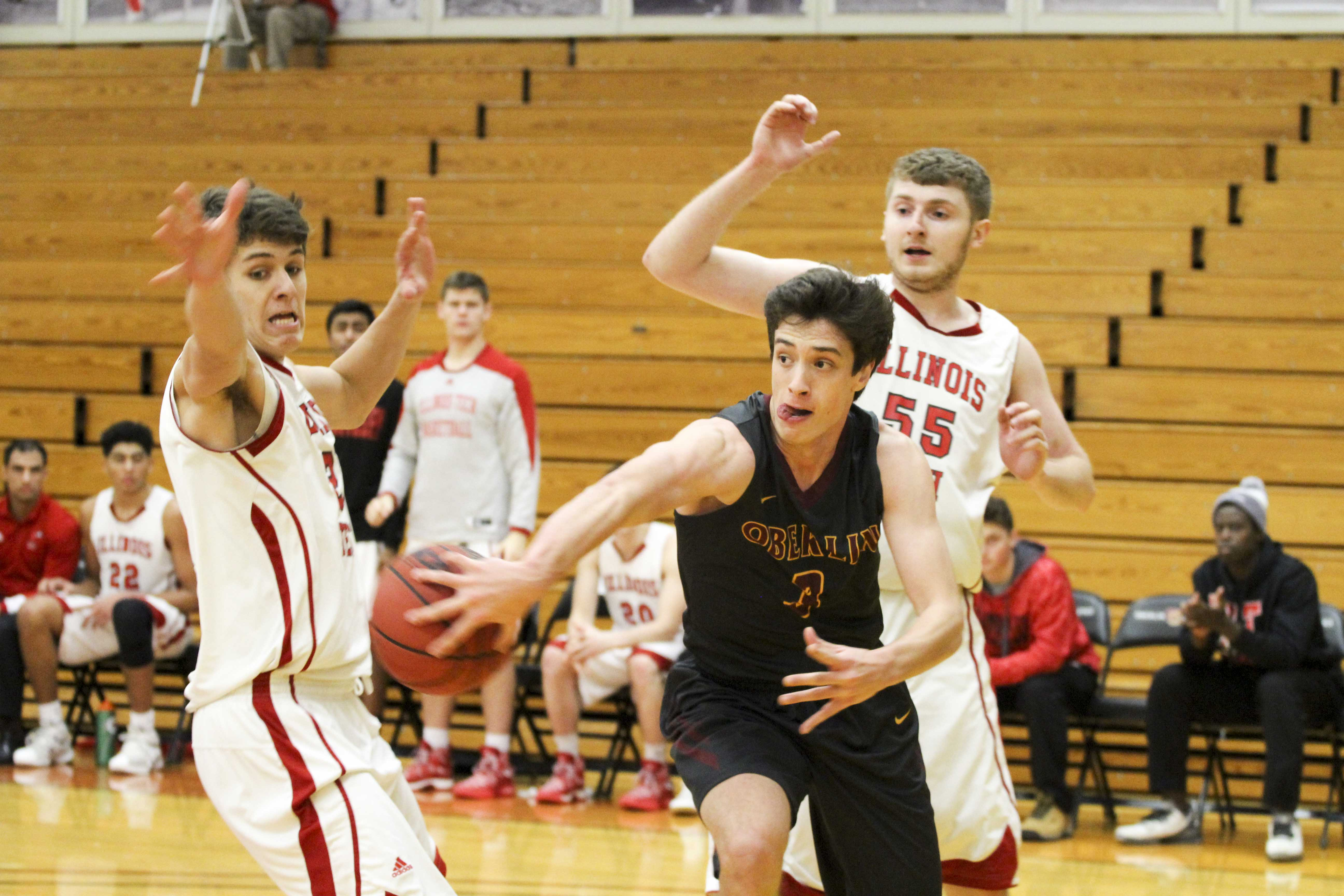Sophomore Eli Silverman-Lloyd attempts to save the ball from going out of bounds against Illinois Institute of Technology during the Thanksgiving Classic, hosted by the Yeomen.