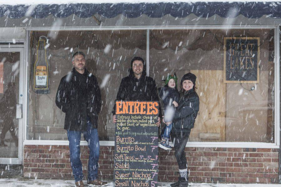 Former Agave Burrito Bar and Tequilaria owner Joe Waltzer, OC '98, (left) stands outside of the burrito bar with new owners Nikki and Jon Stipp and their son Augie. The couple will reopen the restaurant the week of Feb. 20.